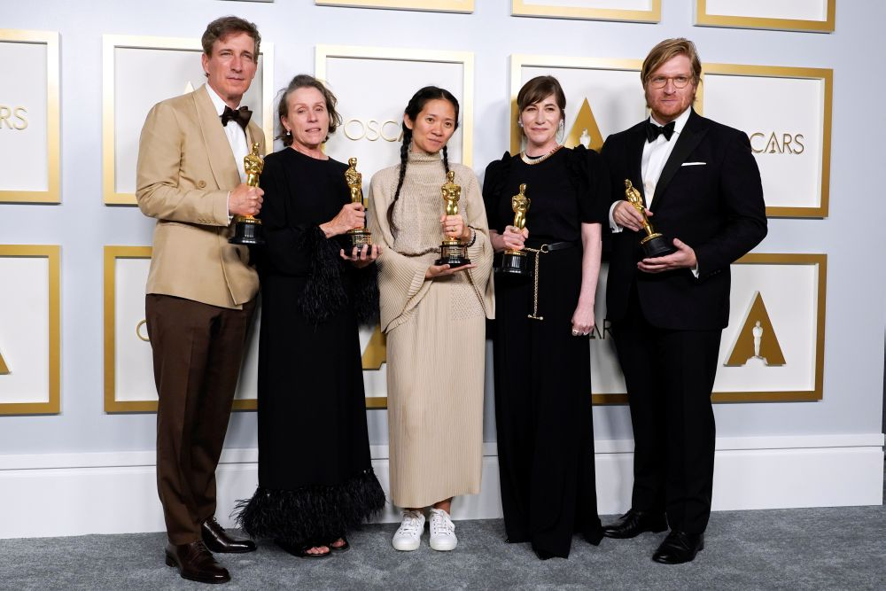 Producers Peter Spears, Frances McDormand, Chloe Zhao, Mollye Asher and Dan Janvey, winners of the award for best picture for 'Nomadland', pose in the press room at the Oscars, in Los Angeles April 25, 2021. — Reuters pic