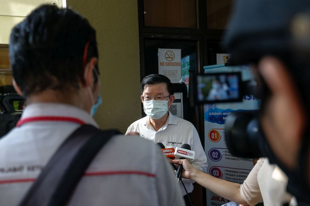 Penang Chief Minister Chow Kon Yeow speaks to reporters during a visit to the Covid-19 vaccination centre at the Caring Society Complex, George Town April 19, 2021. — Picture by Sayuti Zainudin
