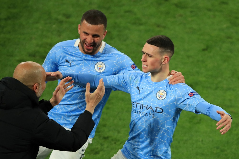 Manchester City's Phil Foden celebrates after scoring their second goal with manager Pep Guardiola and Kyle Walker April 15, 2021. ― Pool via Reuters