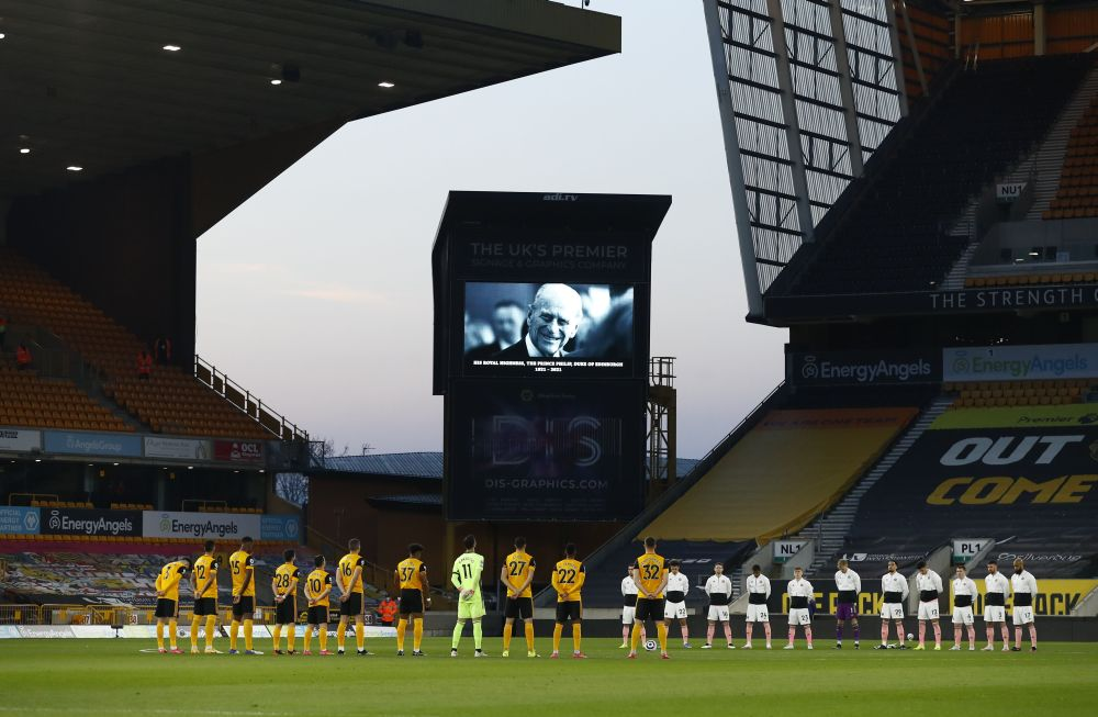 Sheffield and Wolverhampton players observe a minute's silence on the day of the funeral of Britain's Prince Philip at the Molineux Stadium, Wolverhampton April 17, 2021. — Reuters pic