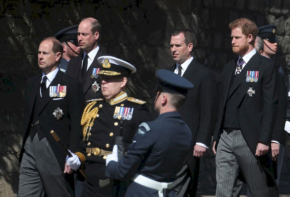 Members of the Royal Family, (from left) Britain's Prince Edward, Earl of Wessex, Britain's Prince William, Duke of Cambridge, Peter Phillips and Britain's Prince Harry, Duke of Sussex, follow the coffin during the funeral procession of Britain's Prince Philip, Duke of Edinburgh to St George's Chapel in Windsor Castle in Windsor, west of London, on April 17, 2021. — AFP pic