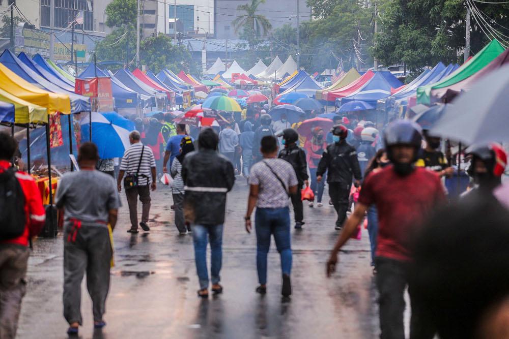 Members of the public throng the Kampung Baru Ramadan bazaar in Kuala Lumpur April 14, 2021. ― Picture by Hari Anggara