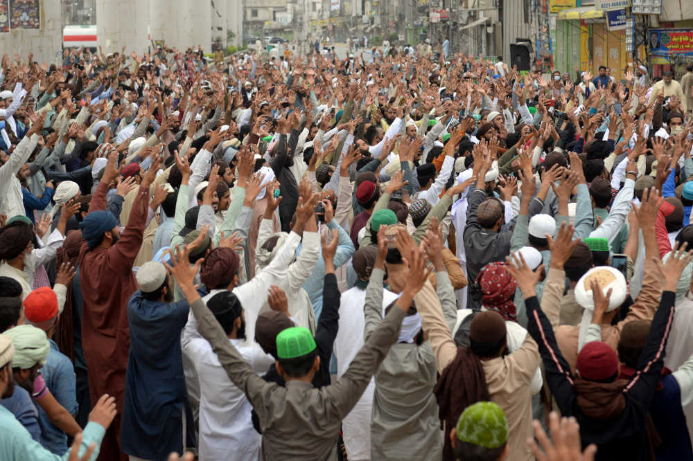 Supporters of the Tehreek-e-Labaik Pakistan (TLP) Islamist political party chant slogans as they protest against the arrest of their leader in Lahore April 16, 2021. — Reuters pic