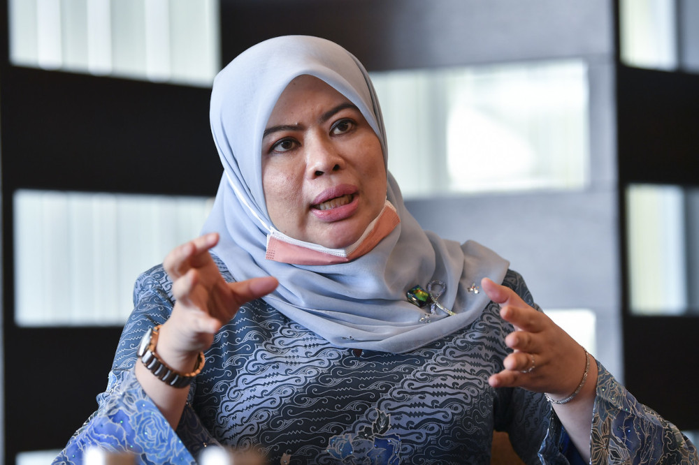 Women, Family and Community Development Minister Datuk Seri Rina Harun speaks to the media after officiating the ministry's NGO Convention in Putrajaya, April 1, 2021. — Bernama pic