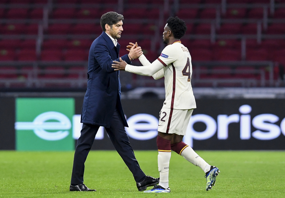Roma coach Paulo Fonseca shakes hands with Roma midfielder Amadou Diawara at the end of the Uefa Europa League quarter-final football match between Ajax Amsterdam and AS Roma at the Johan Cruijff Arena in Amsterdam April 8, 2021. — AFP pic