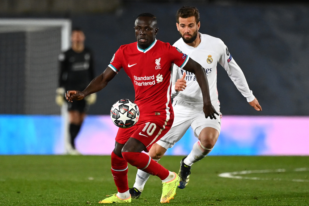 Liverpool striker Sadio Mane in action with Real Madrid defender Nacho Fernandez during the Uefa Champions League first leg quarter-final football match at the Alfredo di Stefano stadium in Valdebebas, April 6, 2021. — AFP pic