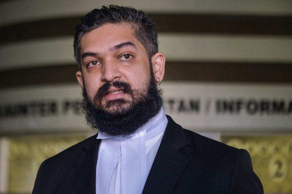 Lawyer V. Vemal Arasan speaks to reporters at the Shah Alam High Court April 21, 2021. — Picture by Miera Zulyana