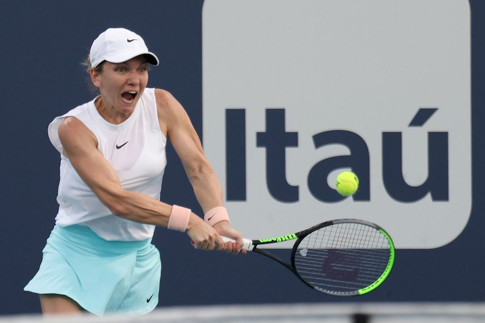 File picture shows Simona Halep of Romania hitting a backhand against Caroline Garcia of France (not pictured) in the second round of the Miami Open at Hard Rock Stadium, Miami, Mar 25, 2021. — Geoff Burke-USA TODAY Sports/Reuters pic