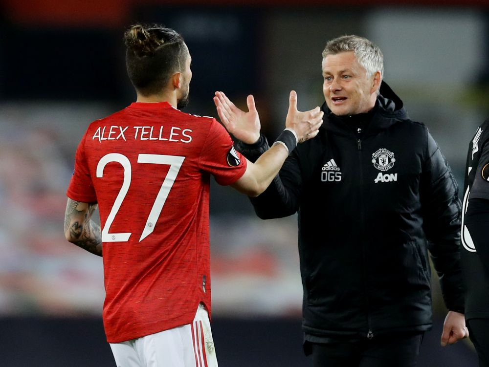 Manchester United manager Ole Gunnar Solskjaer with Manchester United's Alex Telles after the match against Granada at Old Trafford April 15, 2021. — Reuters pic