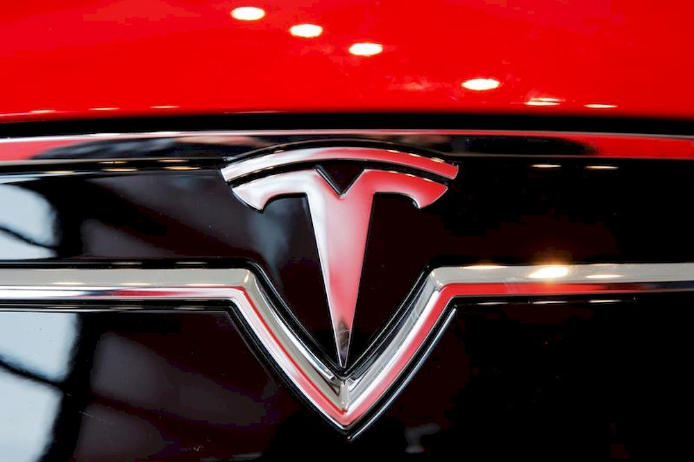 A Tesla logo on a Model S is photographed inside of a Tesla dealership in New York, US, April 29, 2016. — Reuters pic