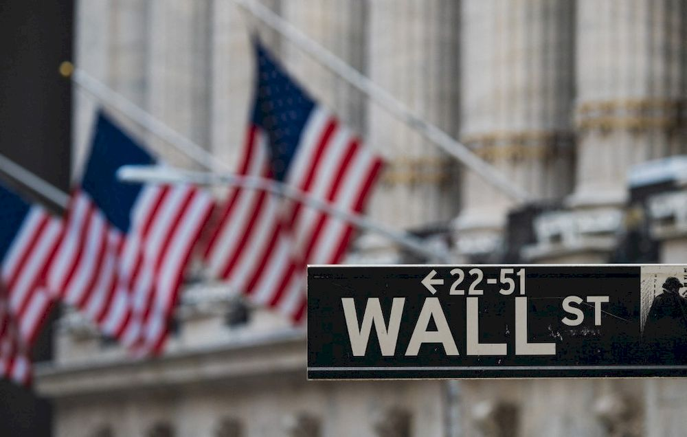 In this file photo a Wall St sign hangs at the New York Stock Exchange (NYSE) at Wall Street on March 23, 2021 in New York City. — AFP pic