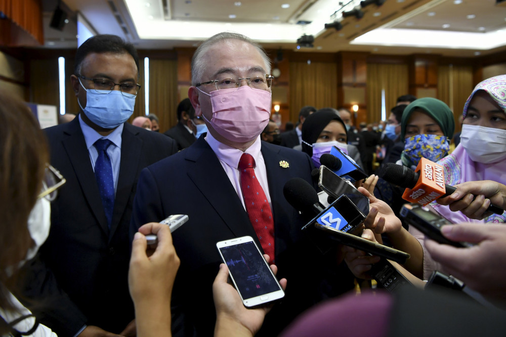 Transport Minister Datuk Seri Wee Ka Siong speaks to the media after an event at the Health Ministry in Putrajaya, April 6, 2021. — Bernama pic