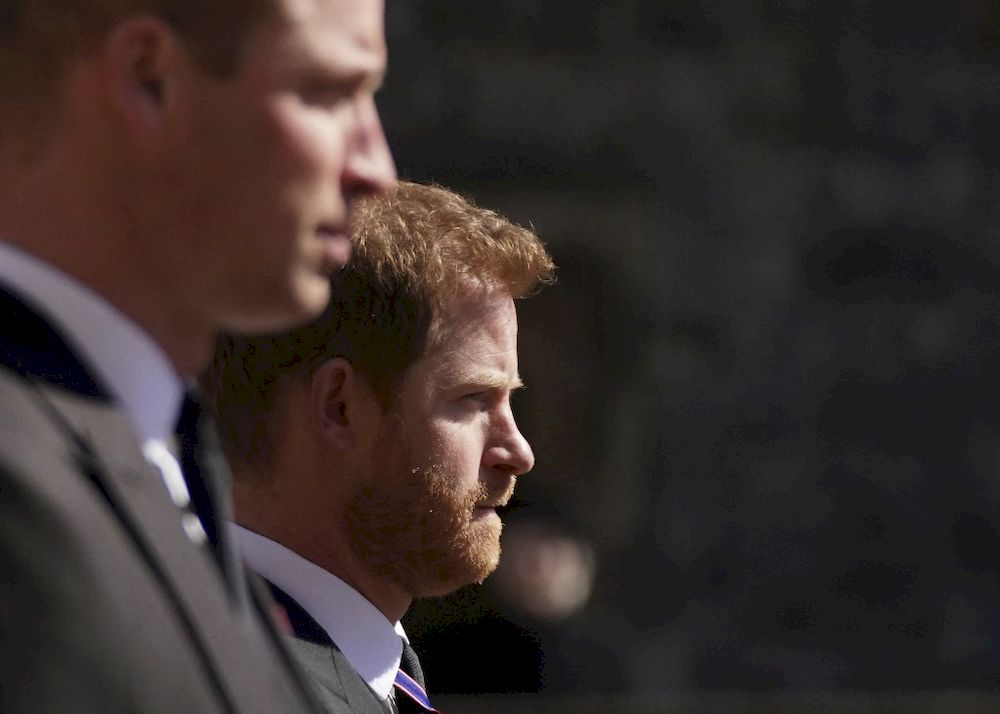 Britain's Prince William, Duke of Cambridge, Peter Phillips and Britain's Prince Harry, Duke of Sussex walk during the funeral procession of Britain's Prince Philip, Duke of Edinburgh to St George's Chapel in Windsor Castle in Windsor, west of London, on April 17, 2021. — AFP pic