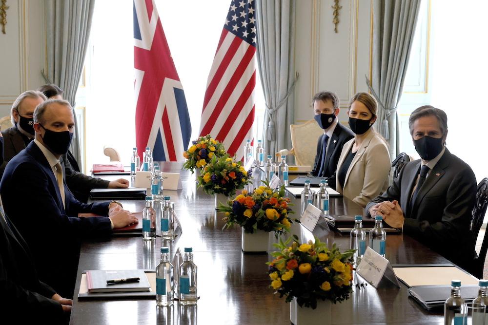 British Foreign Secretary Dominic Raab sits down with U. Secretary of State Antony Blinken at Carlton Gardens for a UK-US bilateral ahead of this week's G7 meetings in London, Britain May 3, 2021. — Jonathan Buckmaster/Pool via Reuters