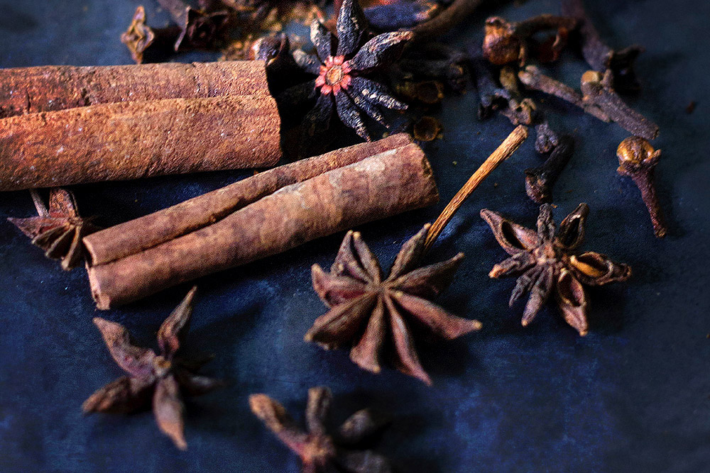 Dried spices such as cinnamon and cloves can add depth to your fruit and flower tea.