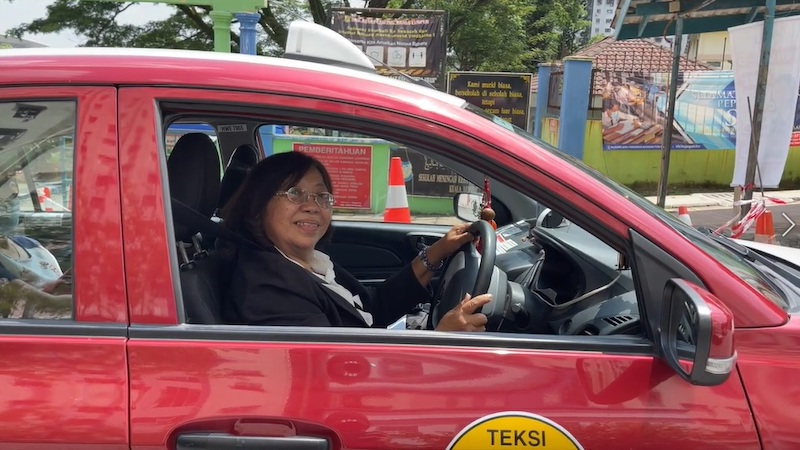 Chong had to tackle her fair share of gender stereotypes when she first became a taxi driver. — Picture courtesy of Fiona Chong Kam Mooi