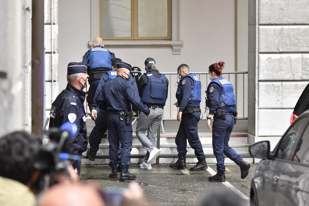 Nordahl Lelandais, is escorted by French prison administration officers as he arrives at the courthouse of the French Alps city of Chambery on May 7, 2021. — AFP pic