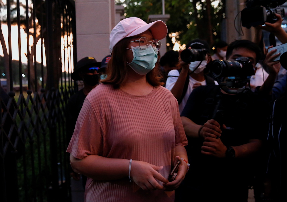 Panusaya 'Rung' Sithijirawattanaku waits for the release of her fellow anti-government protesters, arrested and charged with lese majeste, outside Klongprem Central Prison in Bangkok, Thailand May 11, 2021. — Reuters pic