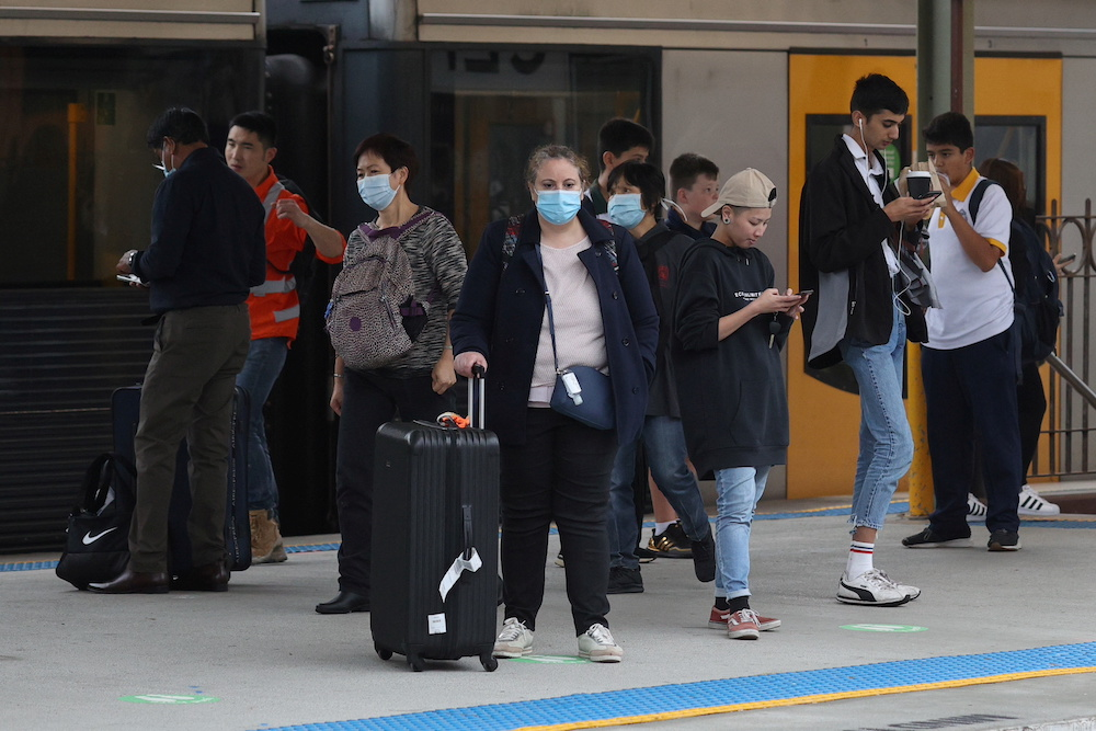 Masks will be made mandatory in trains, buses and ferries from 4pm local time (0600 GMT) today for five days while officials urged Sydney's five million residents to wear them in all indoor venues including supermarkets and theatres. — Reuters pic