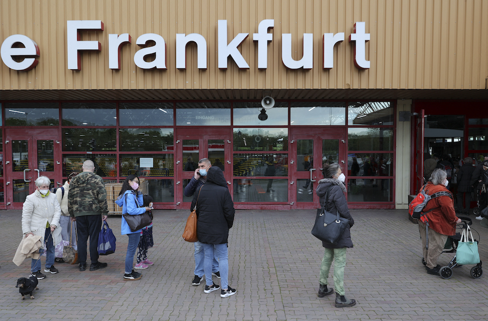 File photo of people queueing to get into the Ice Sport Stadium in Frankfurt on May 19, 2021, after being evacuated following a 500 kg WWII bomb find in the area. — AFP pic