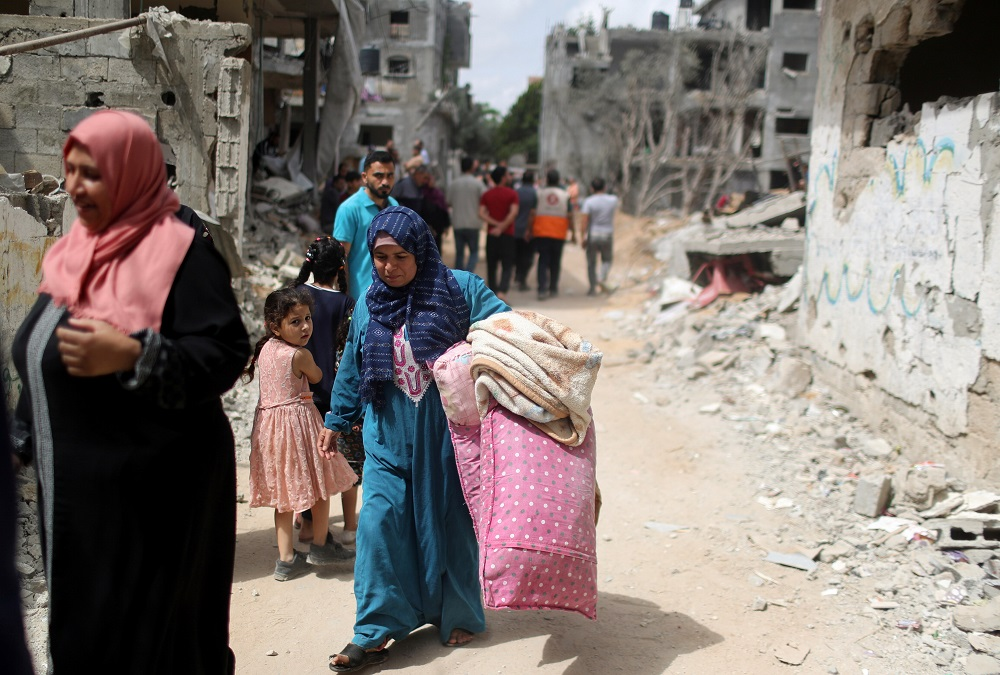 Palestinians return to their destroyed houses following Israel- Hamas truce, in Beit Hanoun in the northern Gaza Strip May 21, 2021. — Reuters pic