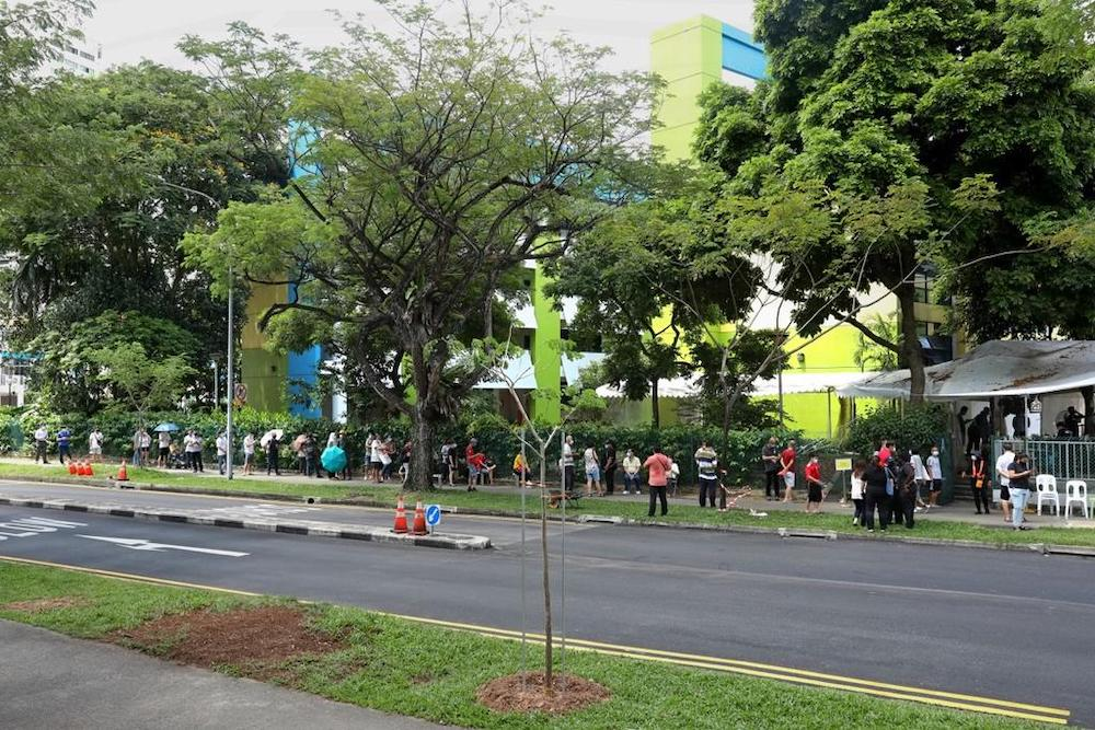 Queues seen outside the former Da Qiao Primary School at Ang Mo Kio, one of the regional screening centres for Covid-19 swab testing, on May 3, 2021. — TODAY pic