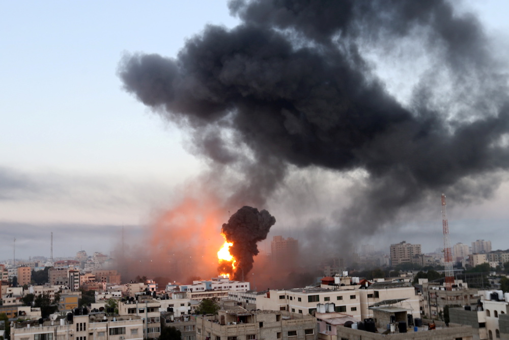 Smoke and flames rise during Israeli air strikes amid a flare-up of Israeli-Palestinian violence, in Gaza May 12, 2021. — Reuters pic