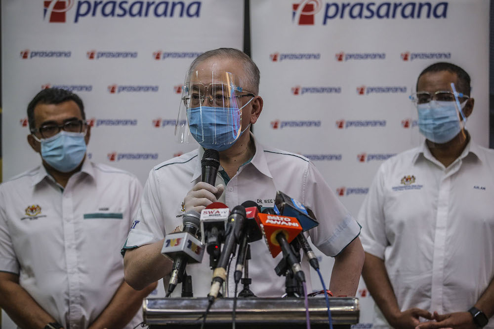 Transport Minister Datuk Seri Wee Ka Siong (centre) speaks to reporters after visiting the crisis centre at the KLCC Light Rail Transit (LRT) station in Kuala Lumpur May 28, 2021. — Picture by Hari Anggara