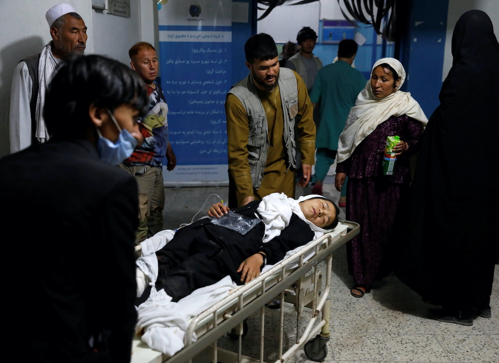 An injured school girl is transported to a hospital after a blast in Kabul, Afghanistan May 8, 2021. ― Reuters pic