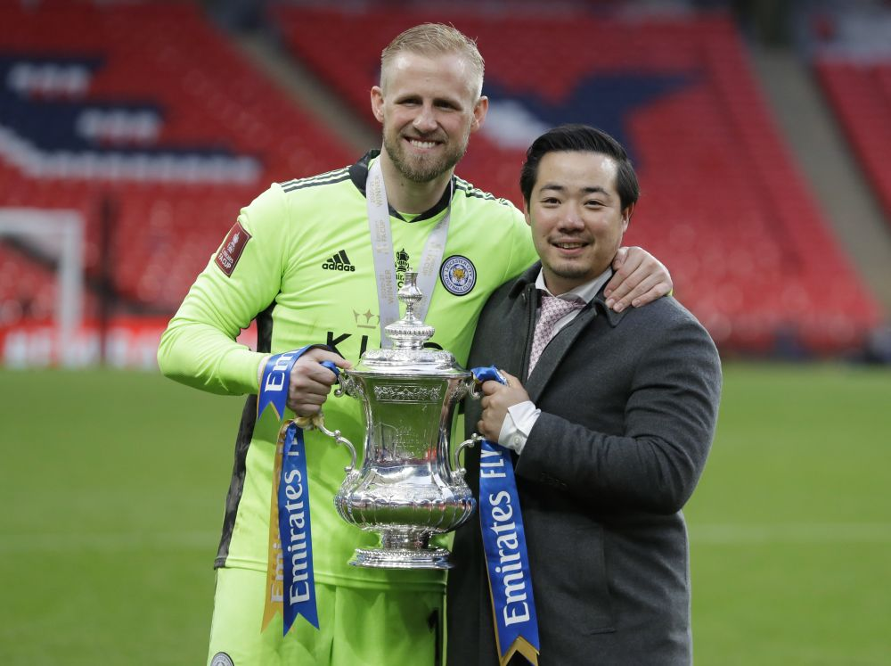 Leicester City chairman Aiyawatt Srivaddhanaprabha and Kasper Schmeichel celebrate with the trophy after winning the FA Cup at the Wembley Stadium May 15, 2021. — Reuters pic