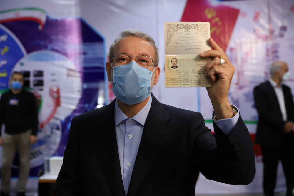 Ali Larijani, former chairman of the parliament of Iran, shows his identification document as he registers as a candidate for the presidential election at the Interior Ministry, in Tehran, Iran May 15, 2021. ― Reuters pic