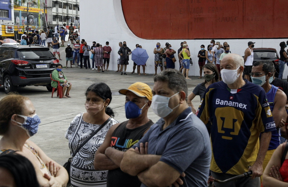 Citizens wait to receive a dose of the AstraZeneca coronavirus disease vaccine, during a vaccination day for 57-year-old and older citizens, in Duque de Caxias near Rio de Janeiro, Brazil April 21, 2021. — Reuters pic