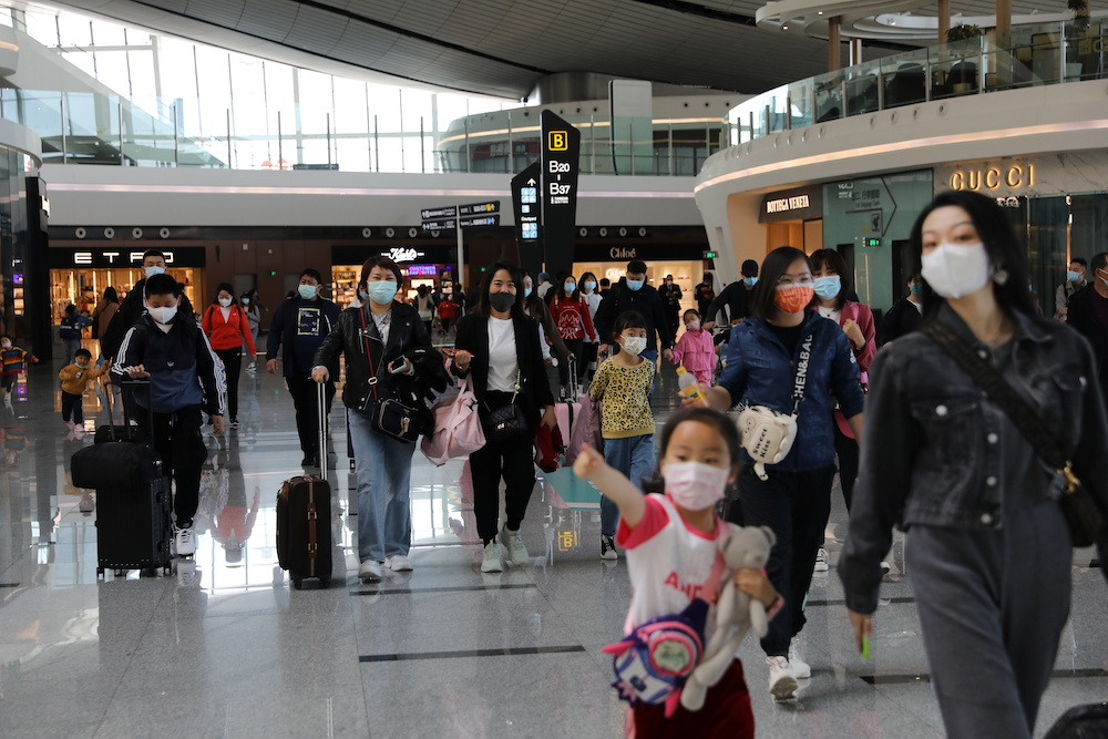 File photo of travellers are seen at the Beijing Daxing International Airport on the first day of Labour Day holiday, in Beijing, China May 1, 2021. — Reuters pic