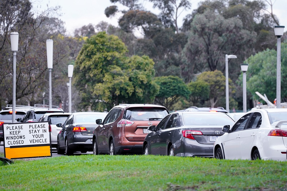 Cars wait in line at a Covid-19 testing centre on the first day of a seven-day lockdown in Melbourne, Australia May 28, 2021. ― Reuters pic