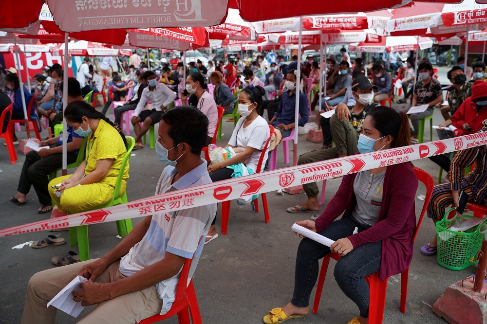 People wait to get tested inside a red zone with strict lockdown measures during the latest outbreak of the coronavirus disease in Phnom Penh, Cambodia April 30, 2021. ― Reuters pic