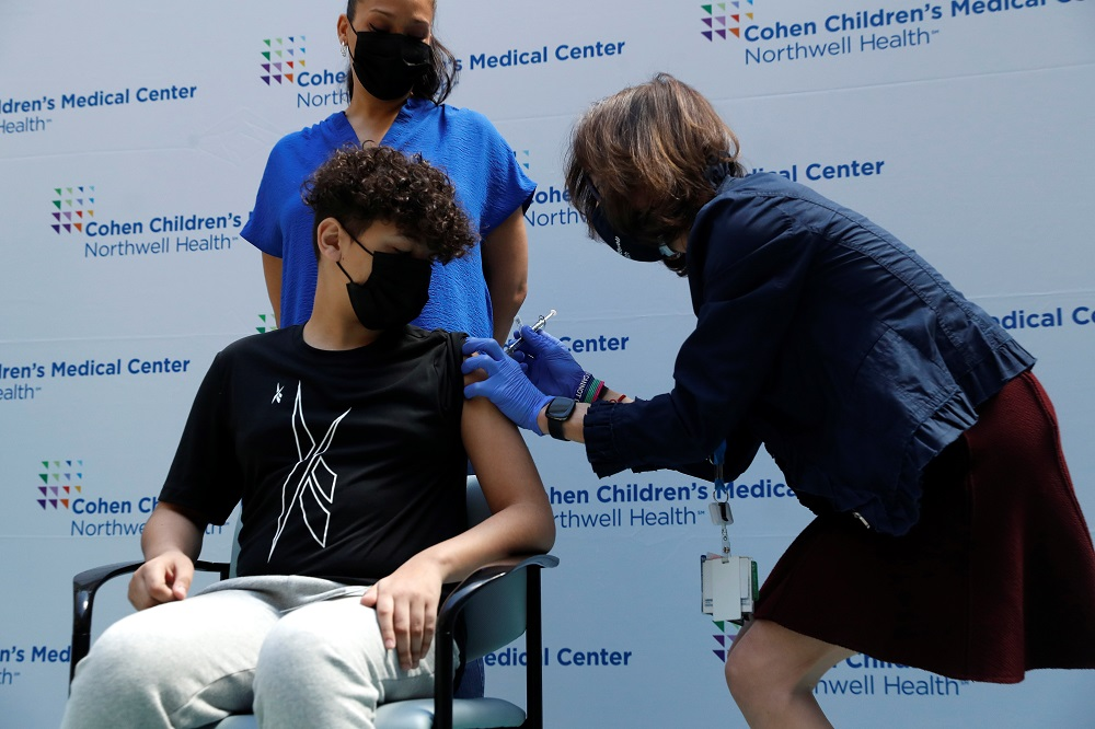 A teenager receives a dose of the Pfizer-BioNTech vaccine at Northwell Health's Cohen Children's Medical Center in New Hyde Park, New York May 13, 2021. ― Reuters pic