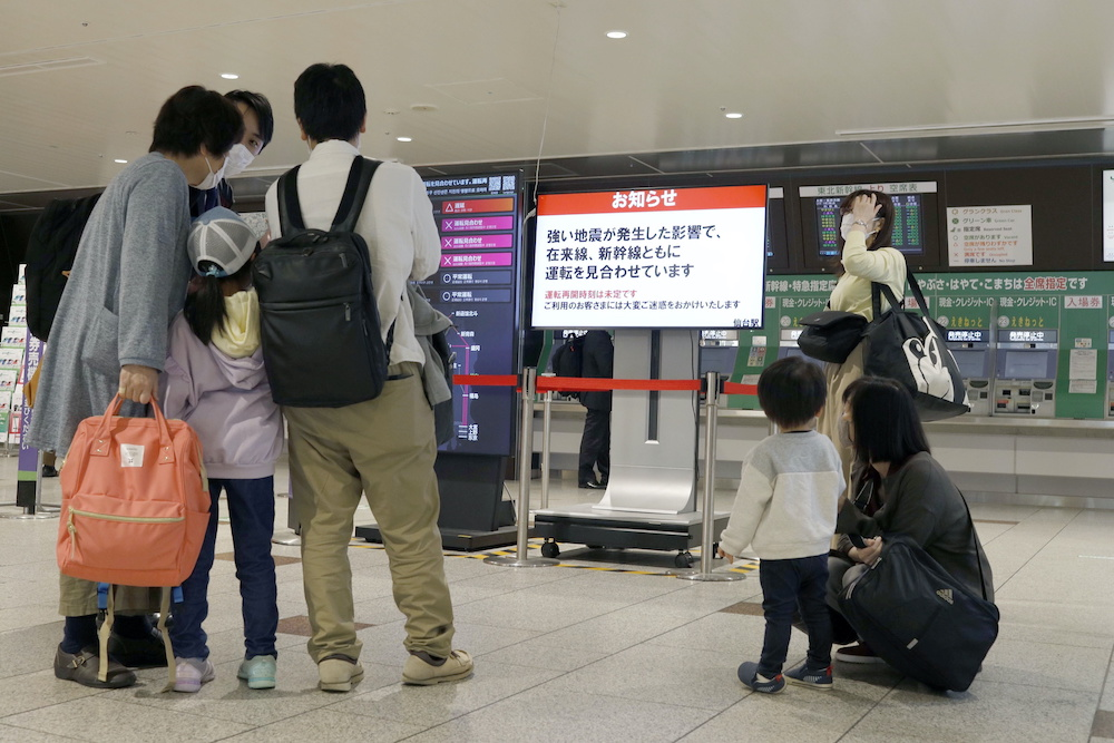 People gather around a ticket gate as train services are suspended following an earthquake in Sendai, Miyagi prefecture, Japan in this photo taken by Kyodo on May 1, 2021. — Reuters pic