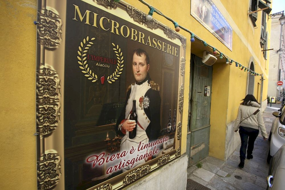 In this file photo taken on March 25, 2021 a woman walks by the Imperial beer Microbrasserie in Ajaccio, Corsica. — AFP pic