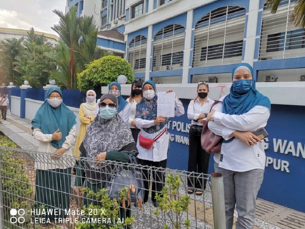 Pejuanita chief Datin Paduka Che Asmah Ibrahim shows the police report outside the Dang Wangi police station in Kuala Lumpur May 4, 2021. ― Picture courtesy of Datin Paduka Che Asmah Ibrahim