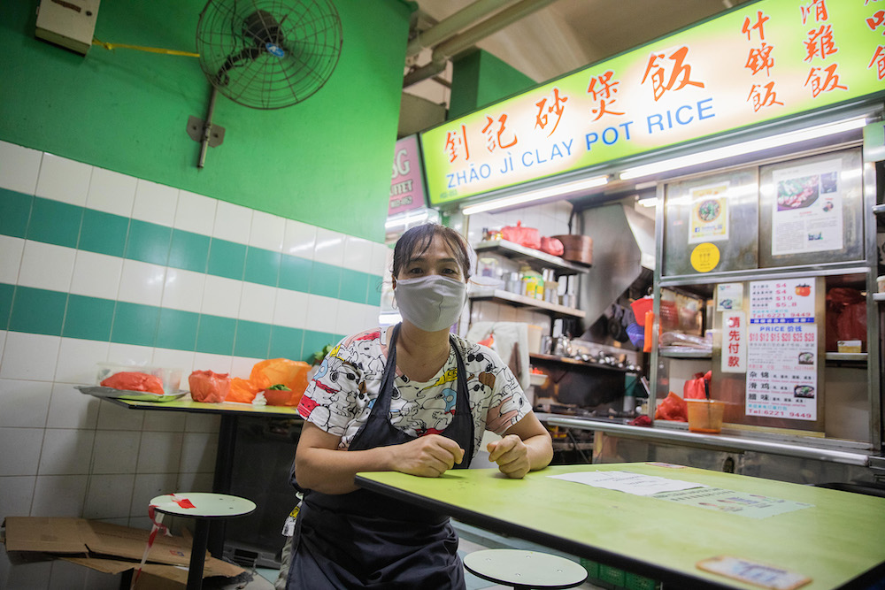 Ms Deng Shu Ling, owner of the popular Zhao Ji Claypot Rice at Chinatown Complex Food Centre, said that her stall is seeing only 5 per cent of its usual crowd. — Photo by Ili Nadhirah Mansor for TODAY