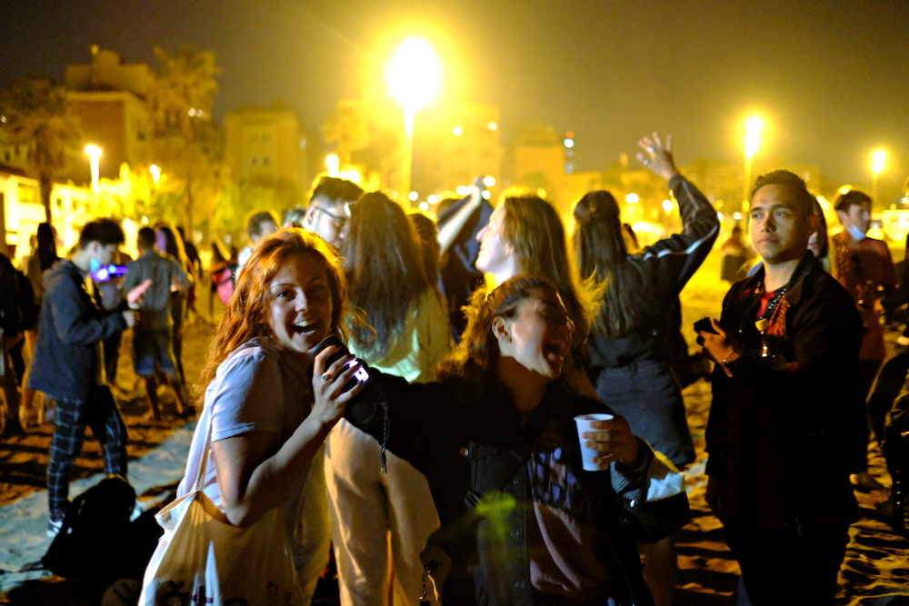 People dance at the Barcelona beach, as the state of alarm decreed by the Spanish Government to prevent the spread of the coronavirus disease is due to end on Sunday, in Barcelona, Spain, May 8, 2021. ― Reuters pic