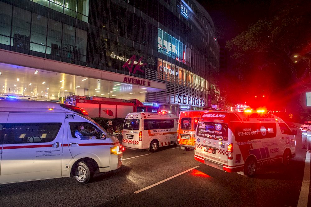 Ambulances are pictured out Avenue K at KLCC, after a collision between two LRT trains on the Kelana Jaya line, May 24, 2021. — Picture by Firdaus Latif