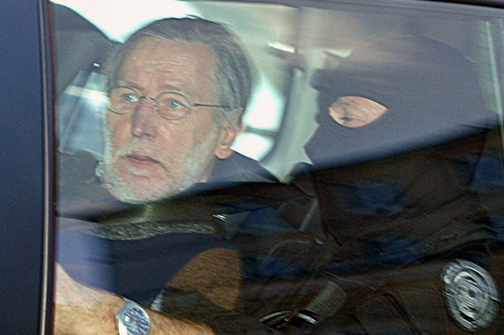 In this file photo taken on May 20, 2008 French self-confessed serial killer Michel Fourniret arrives in a police car to attend his trial at the Charleville-Mezieres courthouse on May 20, 2008. — AFP pic