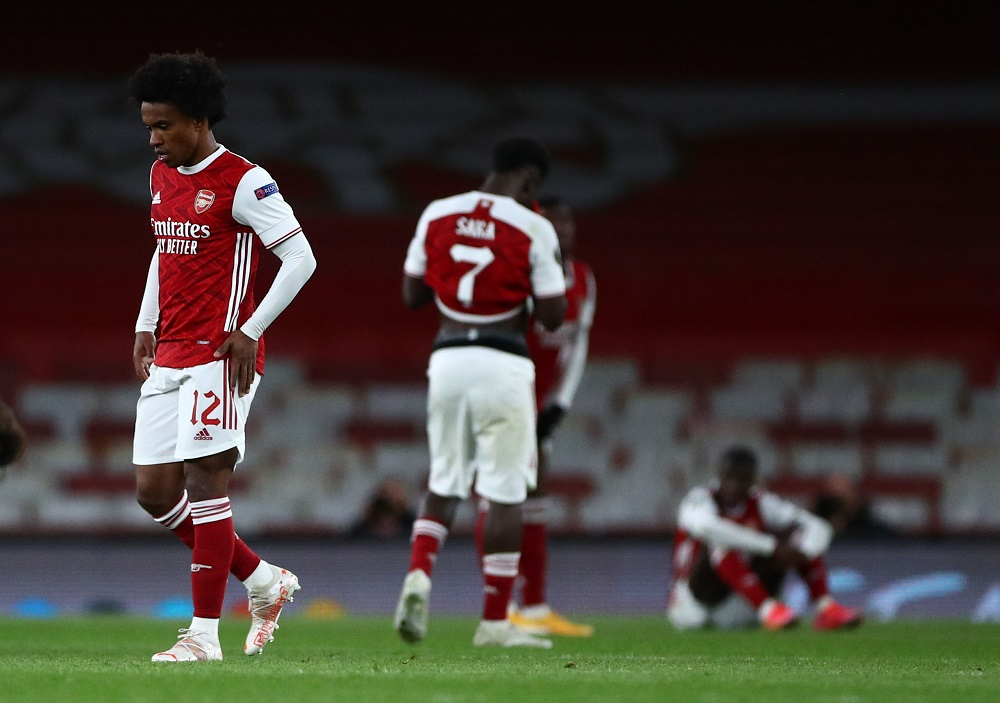 Arsenal's Willian and his teammates look dejected after the match against Villareal May 7, 2021. ― Reuters pic