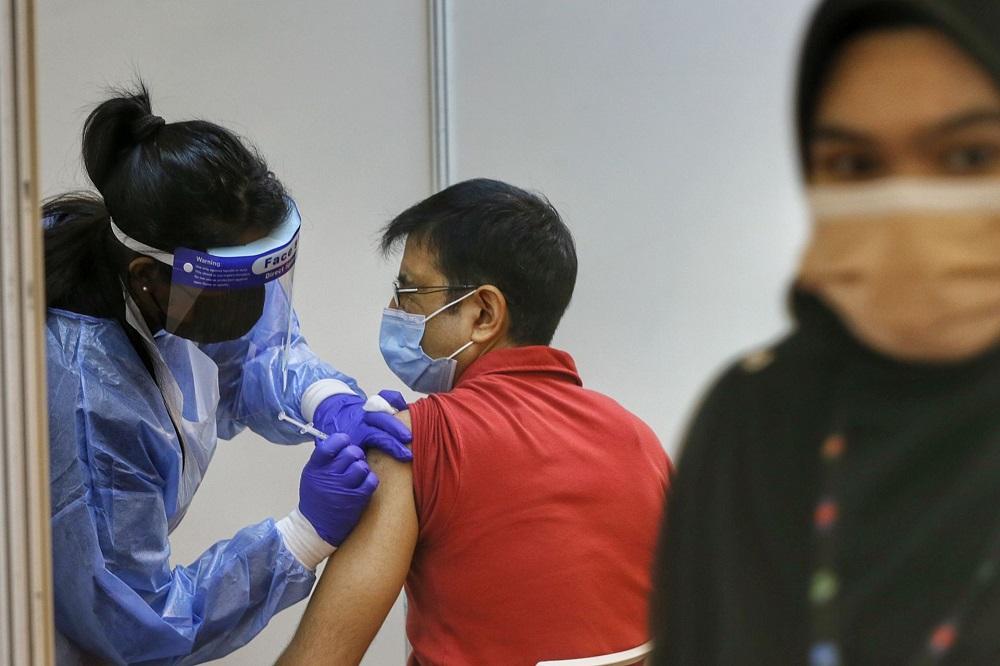 A man receives the AstraZeneca Covid-19 vaccine at the World Trade Centre Kuala Lumpur May 5, 2021. ― Picture by Ahmad Zamzahuri