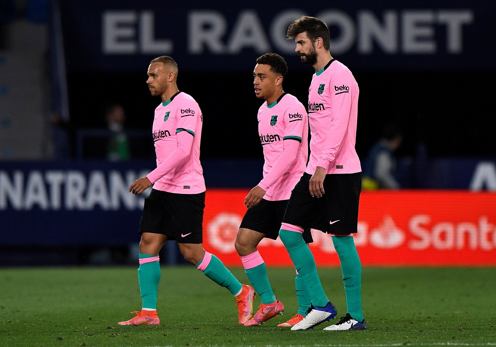 Barcelona's Gerard Pique with teammates look dejected after the match against Levante May 12, 2021. ― Reuters pic