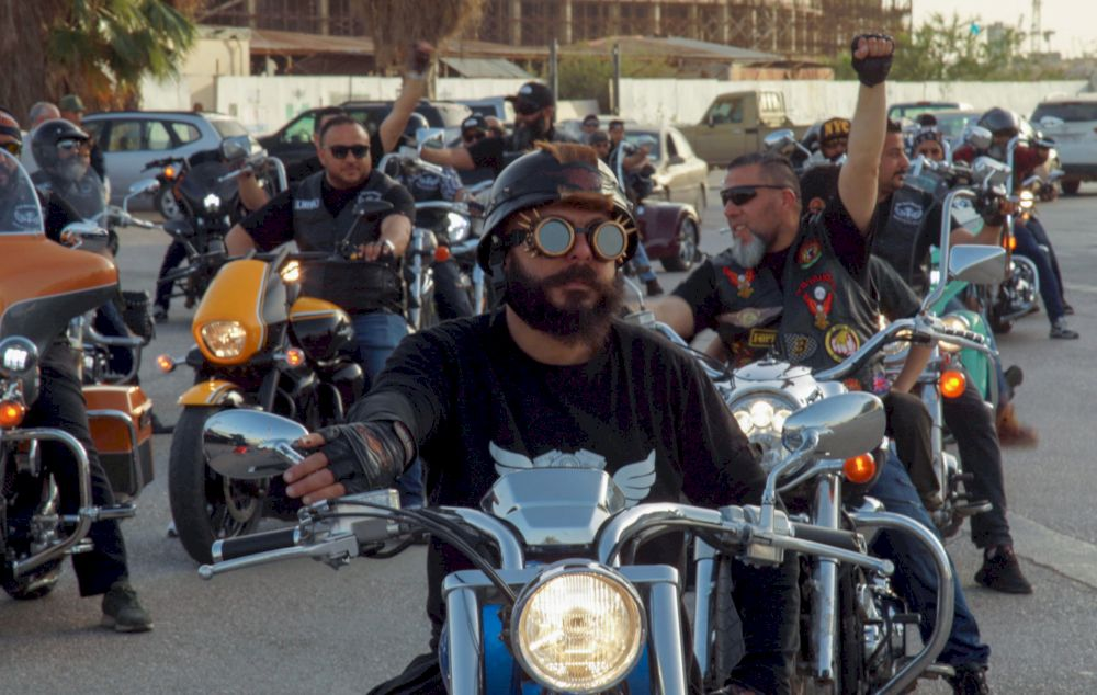Members of Libyan motorcycle clubs take part in a bike ride in the eastern city of Benghazi. — AFP pic
