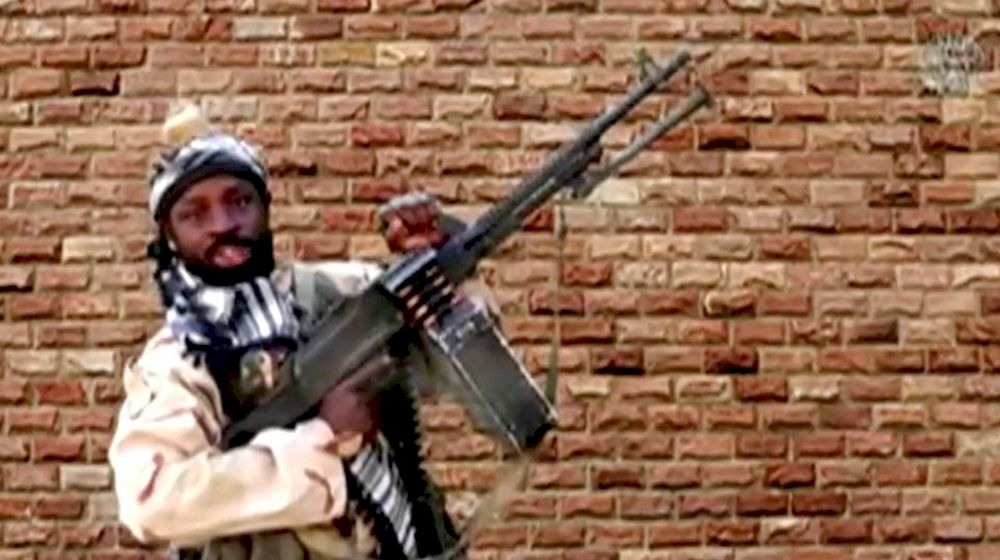 Boko Haram leader Abubakar Shekau holds a weapon in an unknown location in Nigeria in this still image taken from an undated video obtained on January 15, 2018. — Boko Haram Handout/Sahara Reporters via Reuters