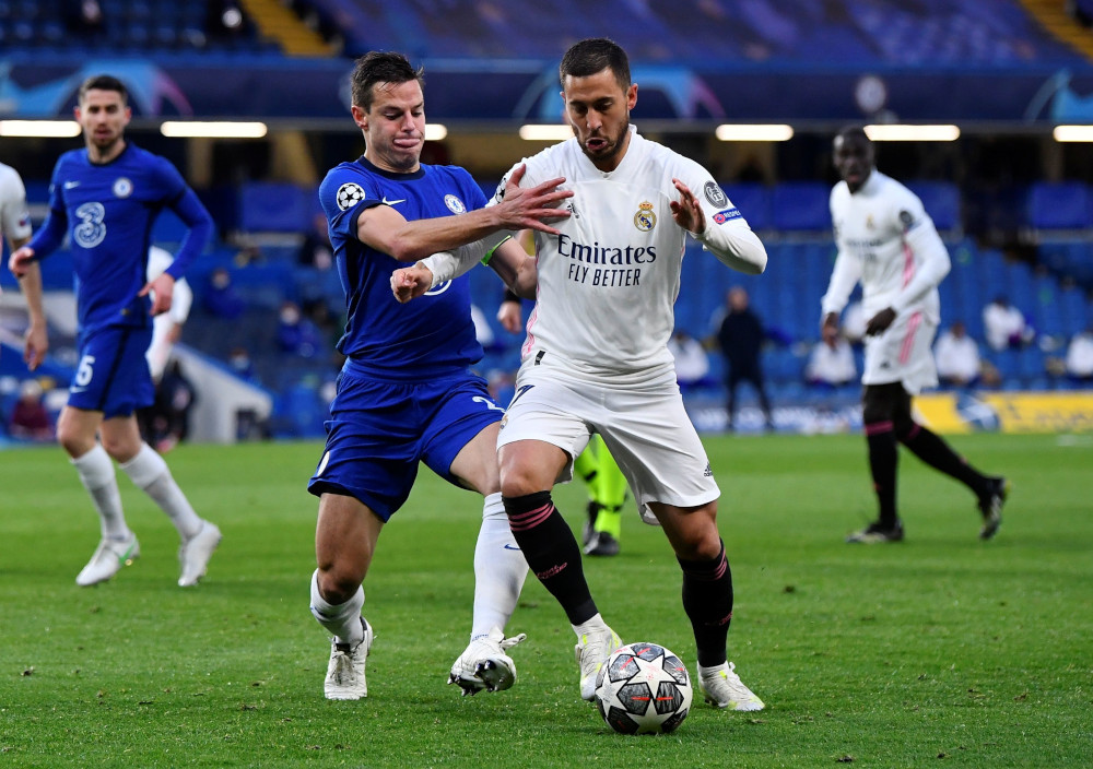 Chelsea's Cesar Azpilicueta in action with Real Madrid's Eden Hazard at the Champions League semi final second leg match at Stamford Bridge in London, May 5, 2021. — Reuters pic