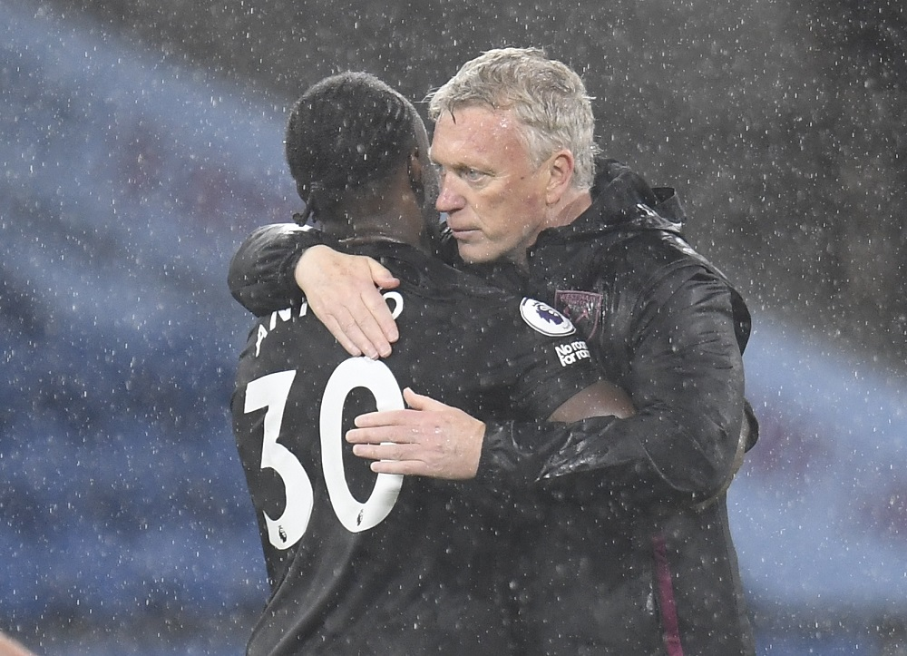 West Ham United's Michail Antonio celebrates with manager David Moyes after the match against Burnley May 4, 2021. ― Pool via Reuters